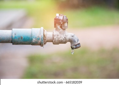 water drop in tap,Leaking water