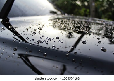 Water droplet on car hood after washed in carcare ,It's shiny and clean.