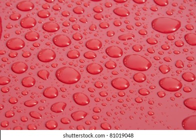 water droplet on red surface