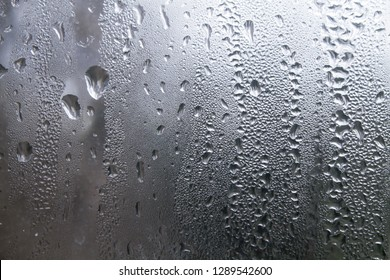 Water droplets from condensation on a glass window.
