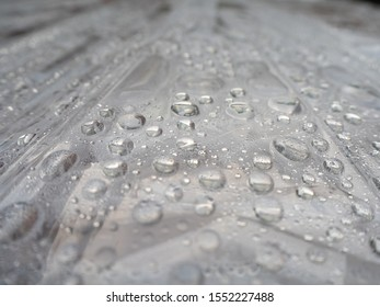 Water droplets isolated on a top of a light surface. Wt backgroun theme. - Shutterstock ID 1552227488