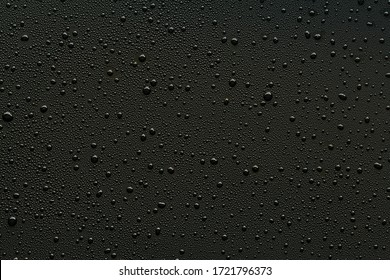 Water droplets on black background.