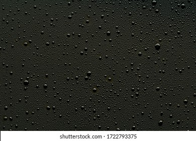 Water droplets on black background