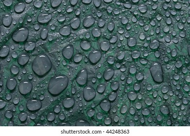 Water droplets on black plastic material