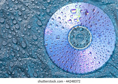 Water droplets on black plastic material with CD disk