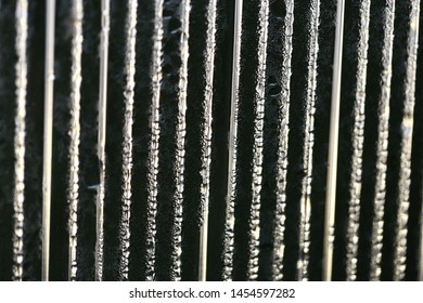 Water droplets on cellular polycarbonate, pattern and structure with variable scale and direction.