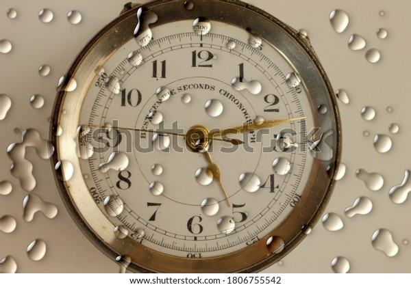 Water droplets on a chronograph pocket watch