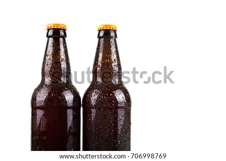 Water droplets on cold beer bottles with white background