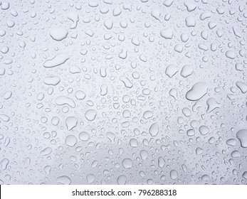 Water droplets on silver background, water droplets wet silver car in the rainy season