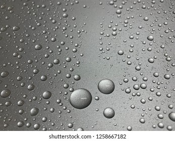 water droplets on silver metal sheet after use glass coating solution.