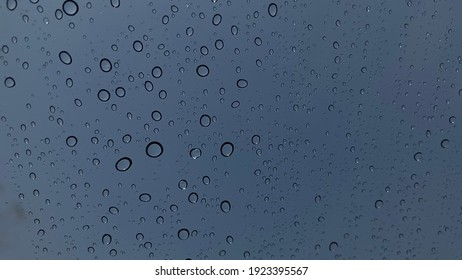 Water droplets perspective through glass surface blue