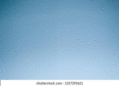 Water droplets spread on window glass look like crystal ball.