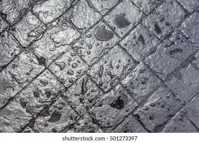 Water dropped on black cement brick tile background.