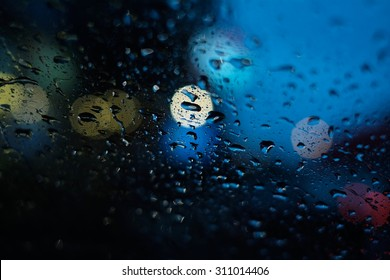 Water Drops in car windows at night.