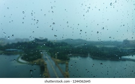 water drops during rainy days with blurred PICC building