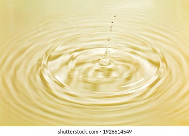 Water drops falling on water surface
