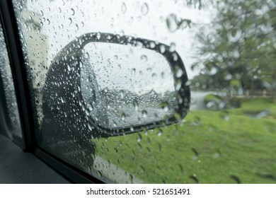 Water drops from inside a car in rain day selective focus