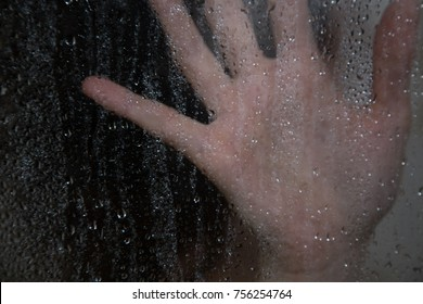 water drops, on the background of the girl who takes a shower
