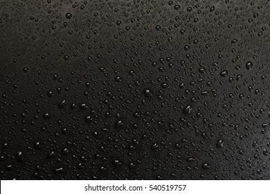 water drops on a black plastic surface