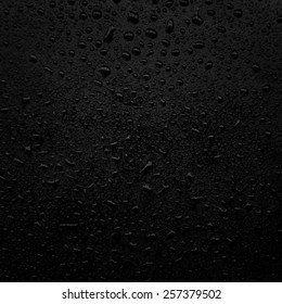water drops on a black surface