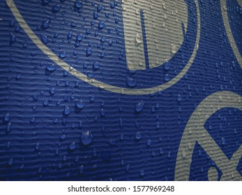 Water drops on a blue swimming pool's exterior. Warning and caution signs. No jumping, drowning risk.