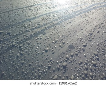 Water drops on a car body metal surface