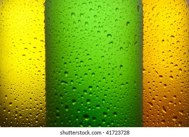 Water drops on different color glass bottles