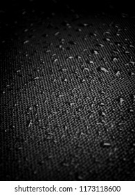 Water drops on the fabric texture. wet textile texture. cloth with water drops. moist fabric pattern.
