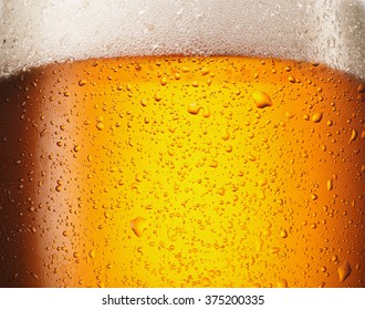 Water drops on glass of beer. Close up beer background.