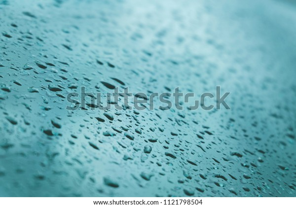 water drops on  glass bright blue background