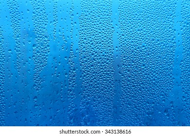 Water drops on glass naural blue texture