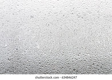 Water drops on glass window. Condensation on the window. High humidity in the room.