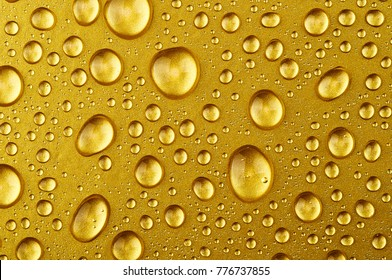 Water drops on a gold background