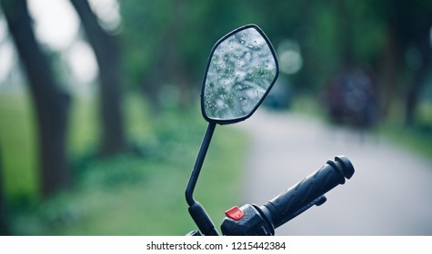 Water drops on a looking glass of a bike unique photo