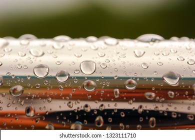 water drops on shiny chrome metal pipe
