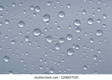 Water drops on a shiny metal surface
