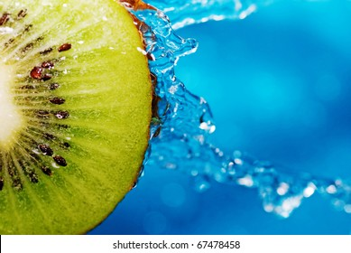 water drops on slice of kiwi