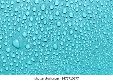 Water drops on smooth surface, light blue background