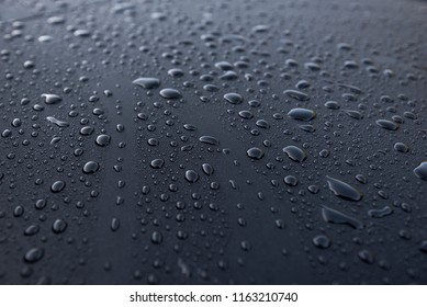 Water drops on a waterproof surface