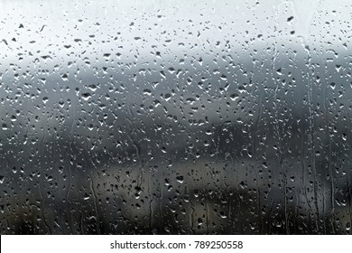 Water drops on window glass - close up photo