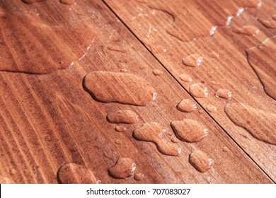 water drops on wooden board closeup