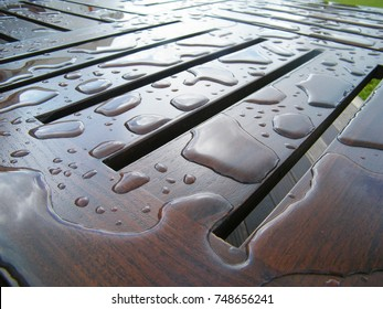 Water drops on wooden furniture surface. Protected hard wood and water resistant paintings.
