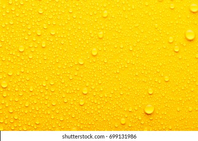 water drops on a yellow background
