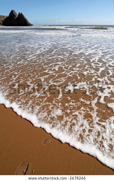 water edge at Three cliff bay