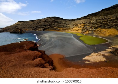 water  in el golfo lanzarote spain musk pond rock stone sky  coastline and summer