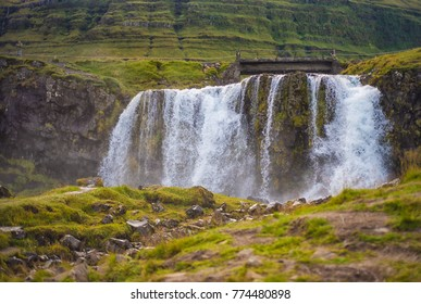 water fall on side of mountain