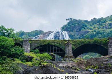water falling from mountain at doodh sagar waterfall, goa