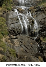 Water falling off a rugged rockface