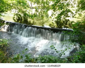Water falling over a weir