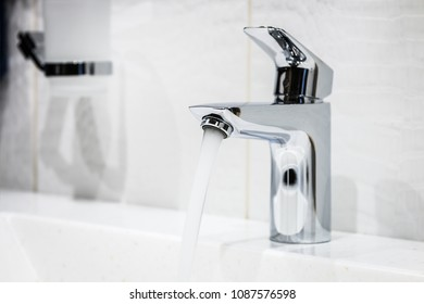 water faucet in the bathroom or toilet. water flows from the tap